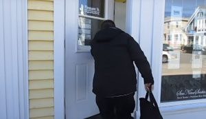 Participant entering business premises in Chester